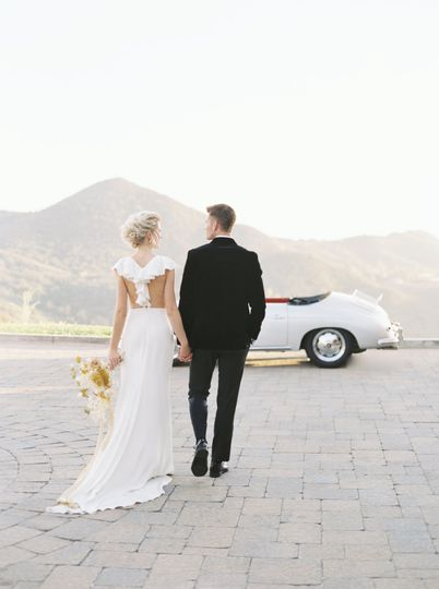 Couple and vintage car