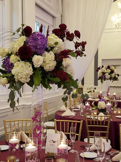 Table setup with floral candle centerpiece