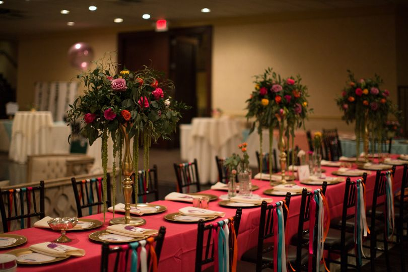 Head table setting and floral centerpieces