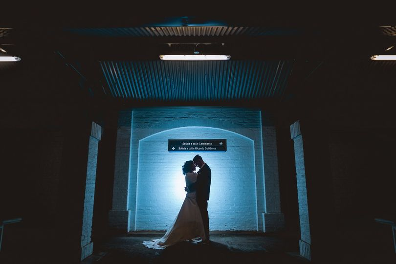 Silhouetted newlyweds at train