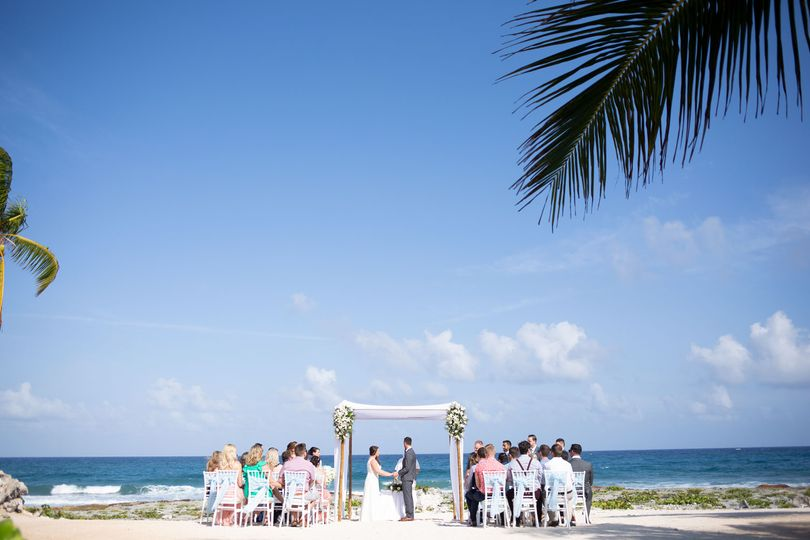 Beach wedding with blue skies