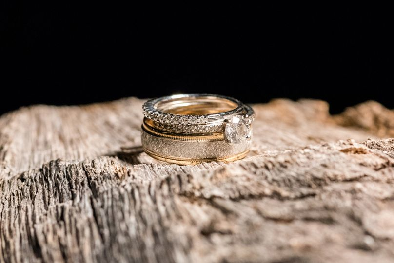 Wedding rings on beach wood