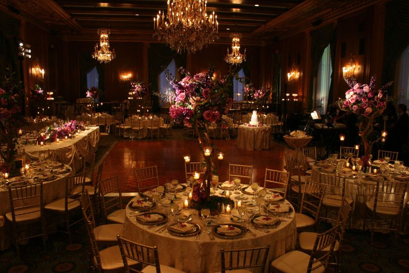 Table with candle and floral centerpieces