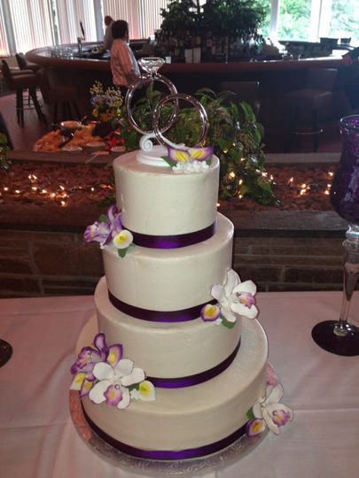 4-tier cake with violet ribbons