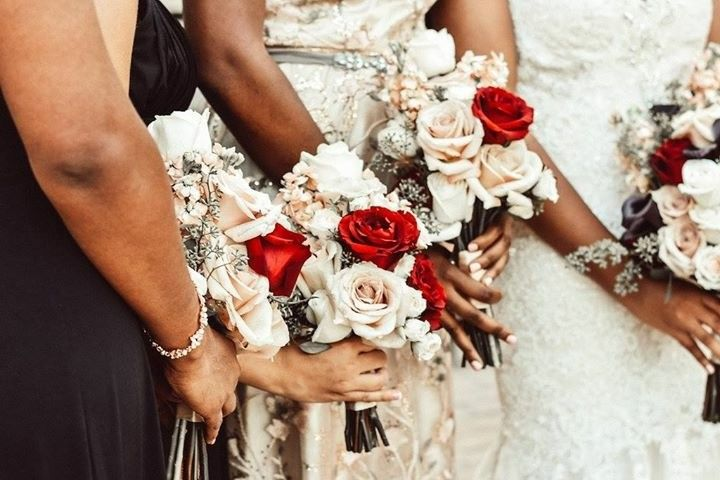 Bride holding her bouquet with her bridesmaid