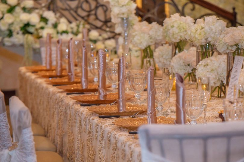 Table setting with floral centerpieces
