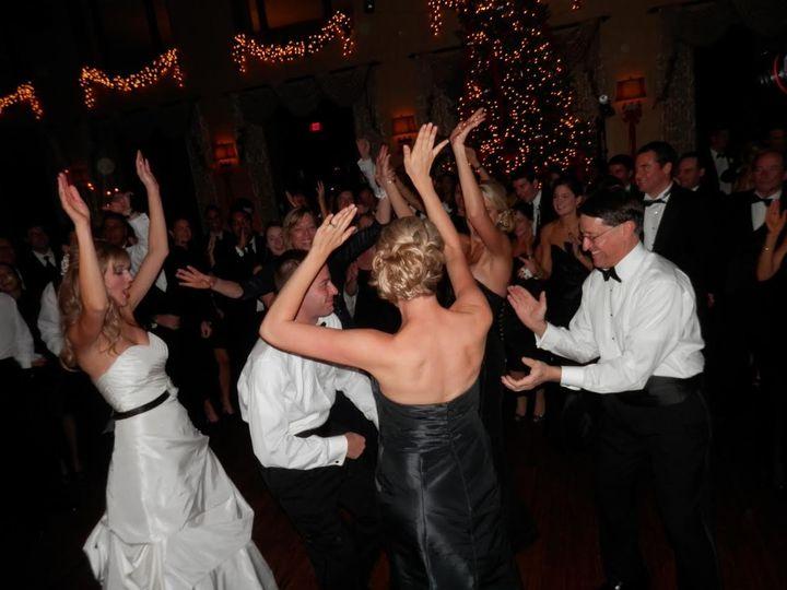 Dancing bridesmaid and groomsmen
