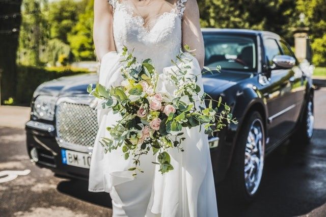 woman in white in front of limo 51 1897111 157955427015265