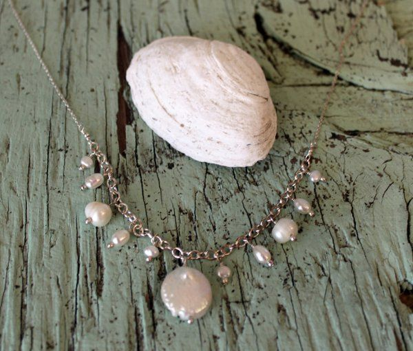 Beautiful staggered sized pearls fall delicately at the neckline in this bridal or bridal party...