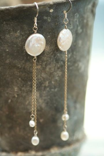 Wonders of a Full Moon - Two stunning Keishi coin pearls give way to delicate strands of silver with...