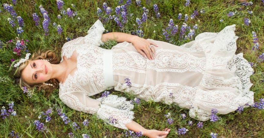 Bride in a field of violets