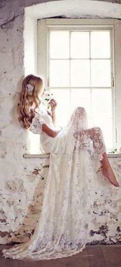 Lace flowing off the shoulder wedding dress