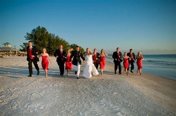 Running in front of the restaurant with their bridesmaids and groomsmen.