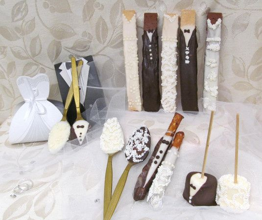 We offer a complete line of gourmet, hand-decorated in white & dark chocolate Bride & Groom edible...