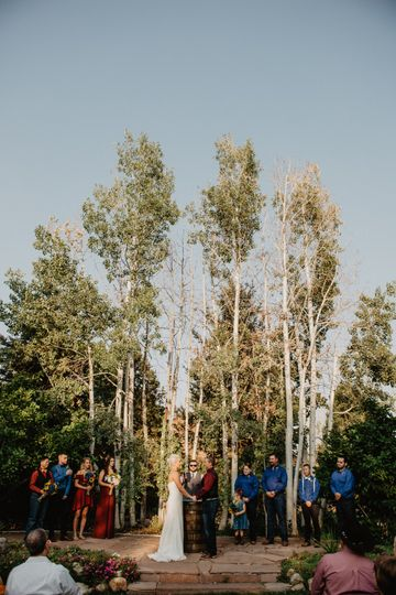 Wedding by tall trees