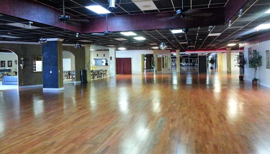 Ballroom dance floor, facing reception area and wet bar with additional seating area.  Hardwood...