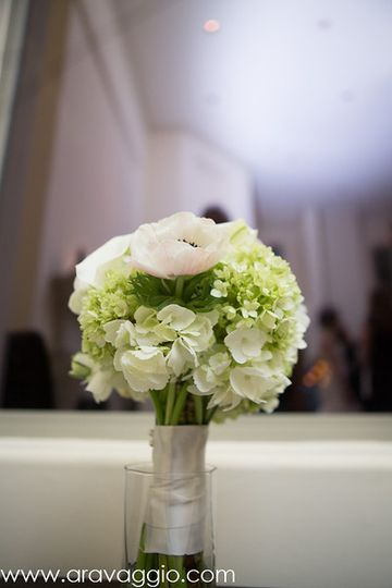 White and green bouquet of hydrangea, anemone, ranunculus, calla lilies, and lisianthus
