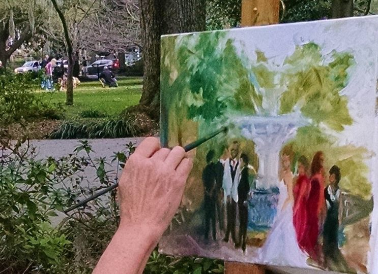 A casual painting, done completely live, during the wedding party's destination photo shoot in front...