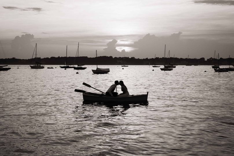 Couple in Rowboat on the Ocean