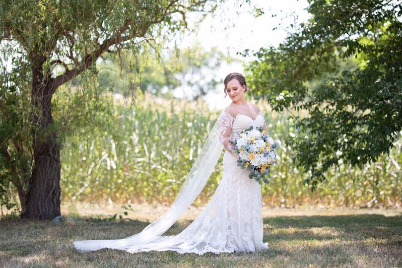 Bride with stunning dress and bouquet