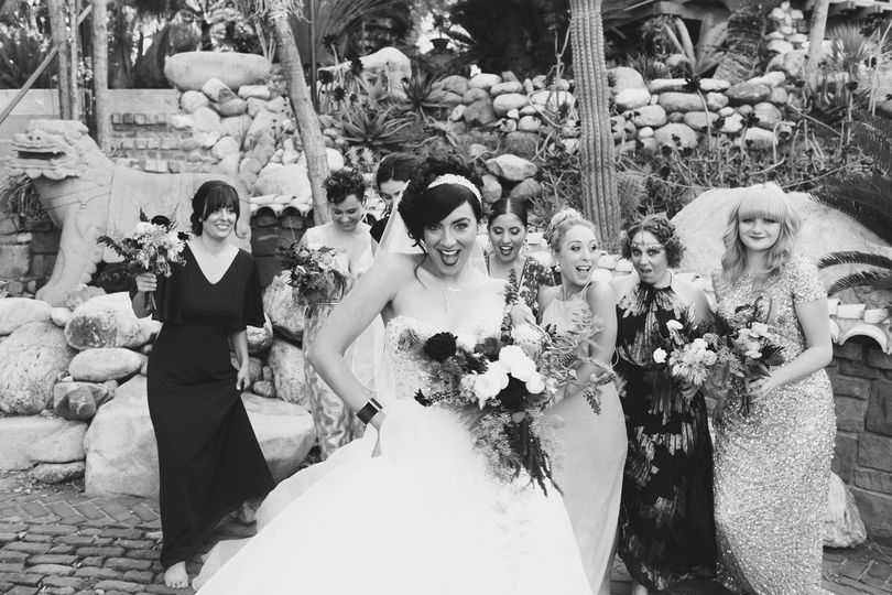 Bride and her bridesmaids sharing laughs