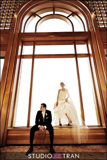Bride and groom against our floor to ceiling windows on our 11th floor.