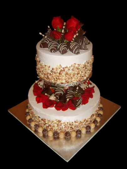 This cake features roses and chocolate covered strawberries. The top tier is tiramisu and the bottom...