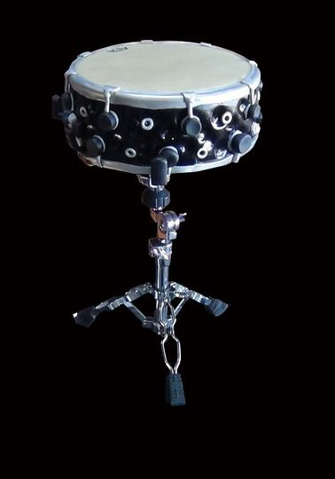 This cake was made for two musicians. The snare drum is modeled after the groom's real snare drum....