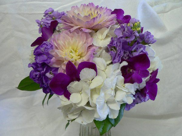 Bridal bouquet of white hydrangia, dalhias, orchids and stock