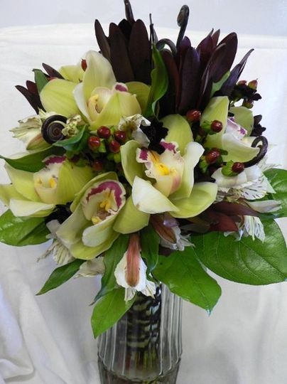 Bridal bouquet of green cymbidium orchids, monkey tails, saffarri sunset, alstomeria lillys and...