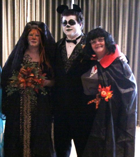 Halloween is when the fun begins for weddings.  She was a Tiger, he a Panda.  Oh yes, that's me as...