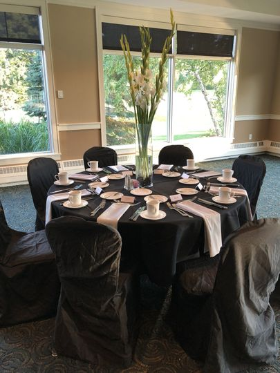Tables and chairs with formal black covers