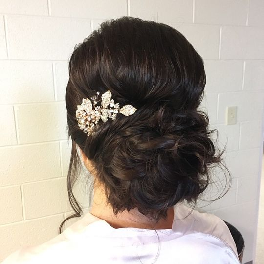 Curly bun with decorative hair piece