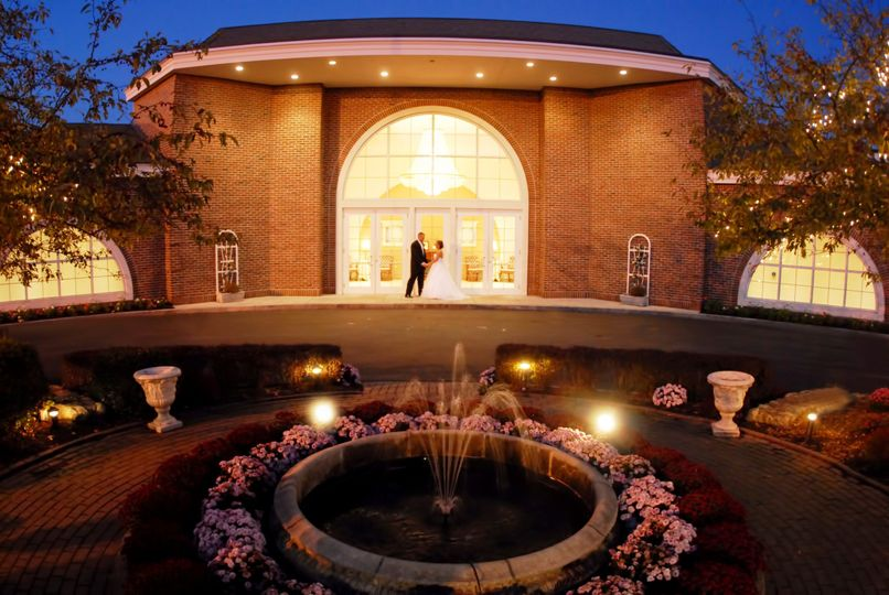 Couples dance in view of venue