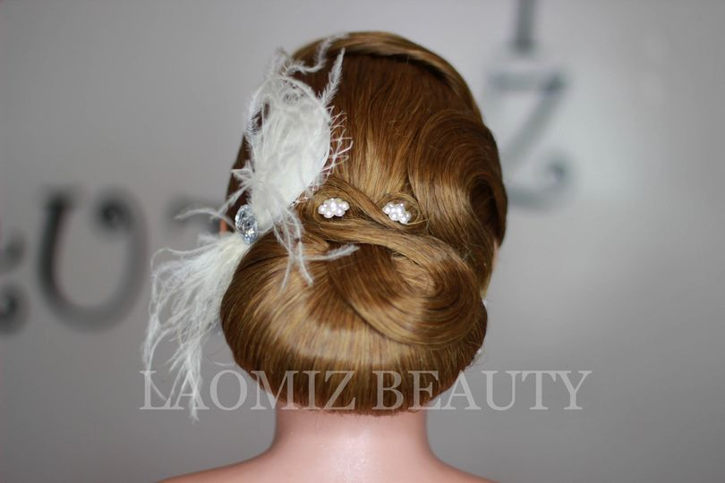 Updo with feathers