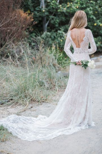 Backless dress with long trail