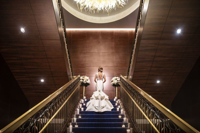 the ritz carlton denver weddings bride grand staircase primary 51 597511 v2