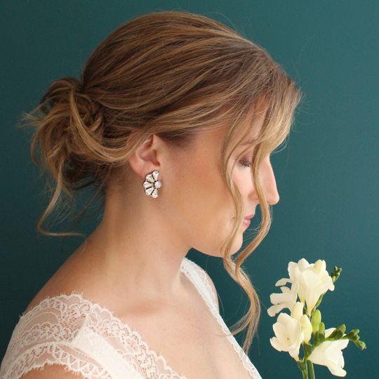 Sunburst floral earrings on bride