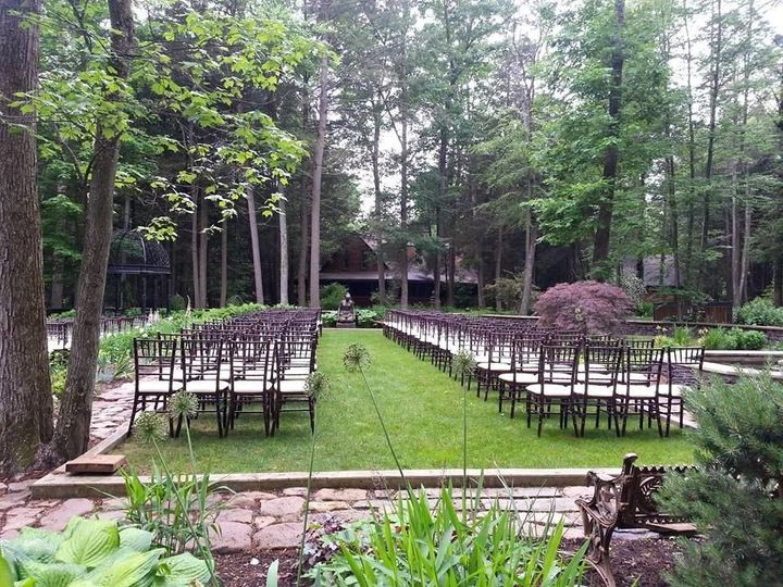 Sculpture Garden Ceremony with rented chairs