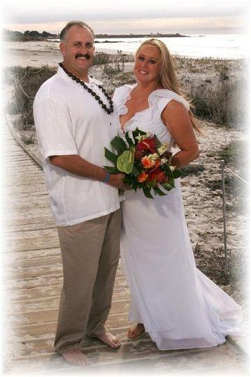 Robin wearing her barefoot sandals for her beach wedding.