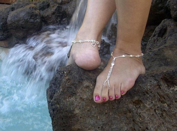 Wedding barefoot sandals embellished with charms.