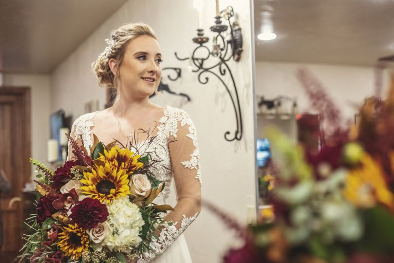 Bride and sunflower bouquet