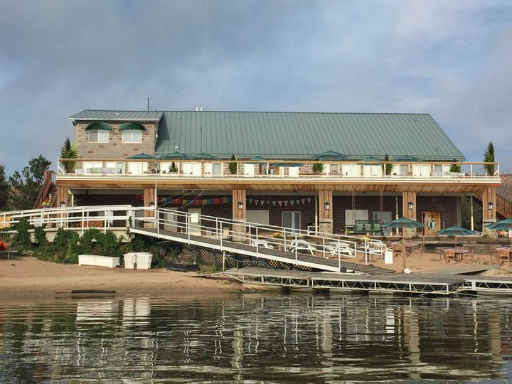 A view from the water illustrates the size of The Lake House. The smaller third level is the...