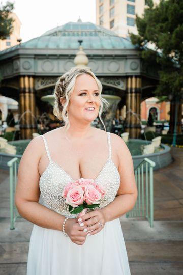 Bride holding a romantic pink bouquet