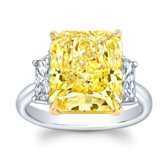 One of a kind Fancy Yellow Diamond Radiant Diamond Ring.