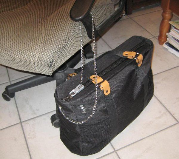 Black Kyss Bag anchored and locked to an office chair.