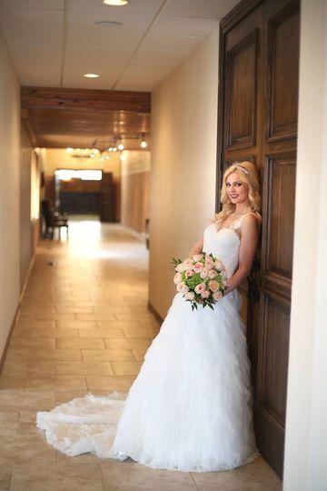 Bride leaning on the chapel door