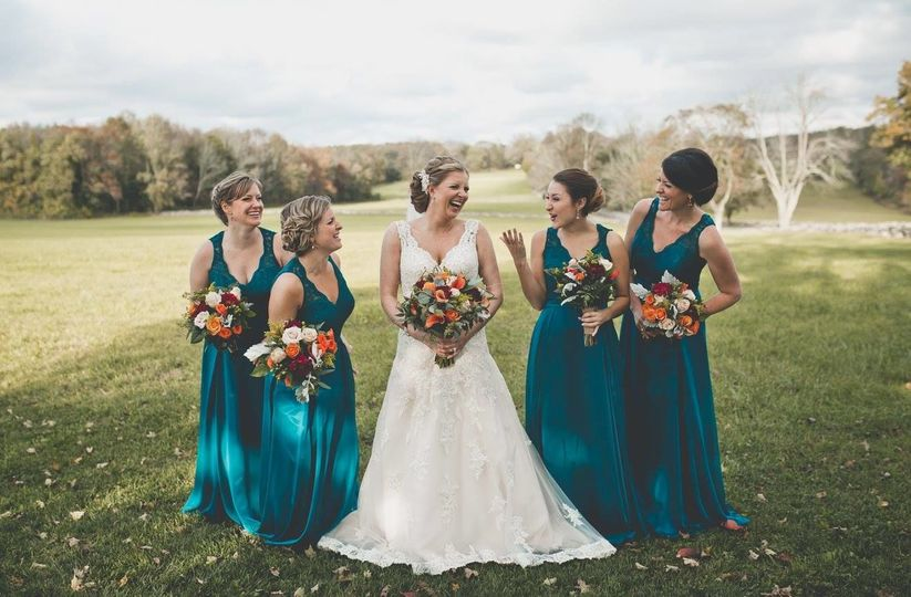 Bride and bridesmaids in the field