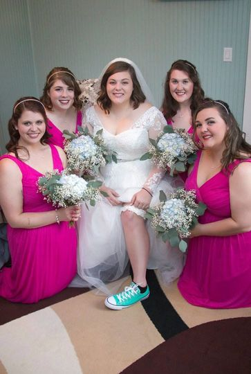 Brides and bridesmaids all dressed in the bridal cottage