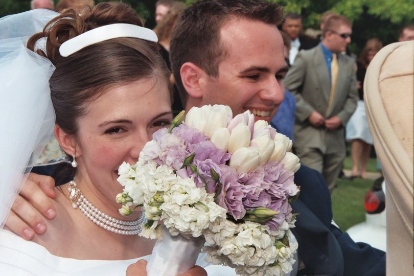 Bridal Bouquet created with white tulips and lavender Lisianthus and white stock.  Designed by Bill...